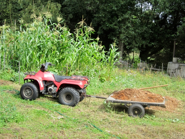 quad and trailer of manure