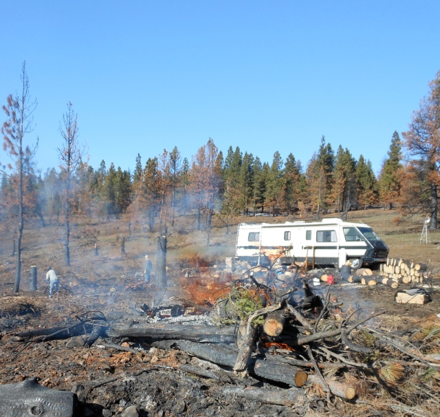 motorhome with burning wood pile