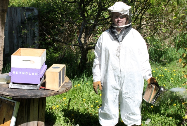 donna in bee outfit with smoker