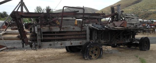 Old baler with hay bales still inside