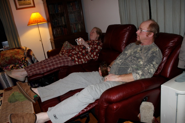 tom-and-donna-watching-charlie-brown-sipping-egg-nog-and-cider-on-new-christmas-present