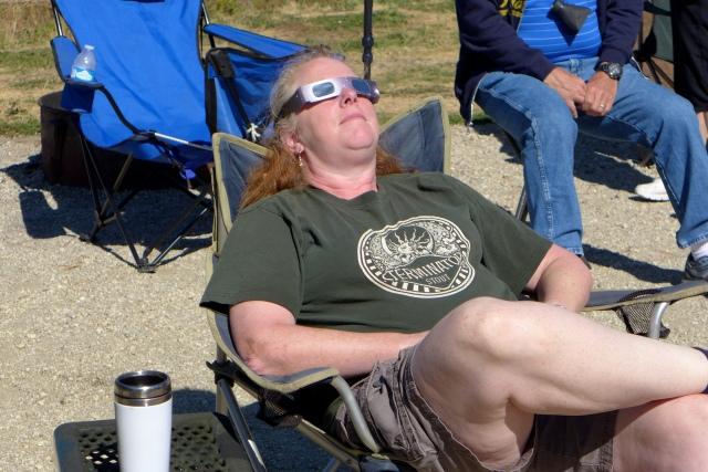 Donna watching eclipse