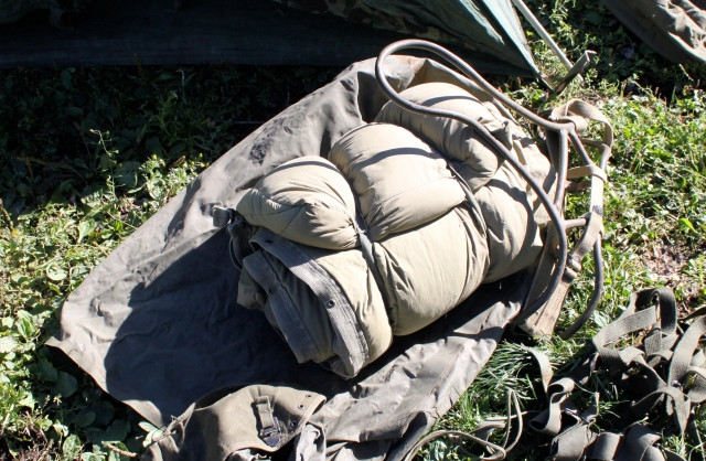 sleep bag, pack frame and gear bag