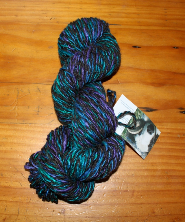 handspun 50% silk & 50% Opal roving from Chasing Rainbow Dyeworks plied with our black Shetland wool, 2 ply, ~3 oz, ~90 yards, $32