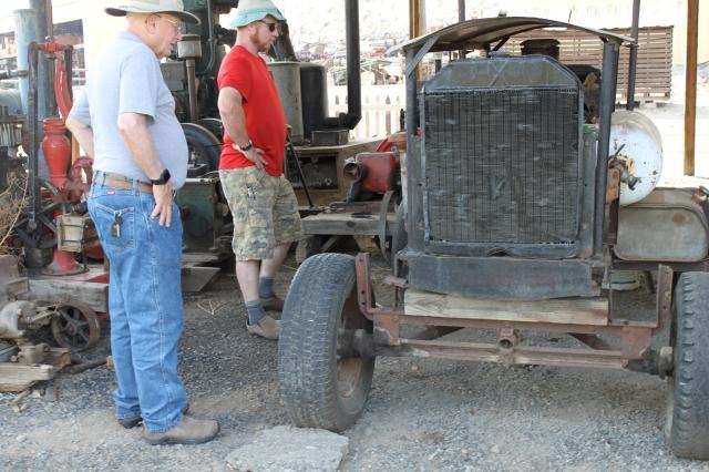 Al and Tom looking at compressor