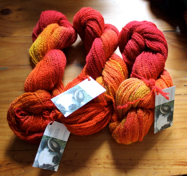 Sunset dyed yarn skeins