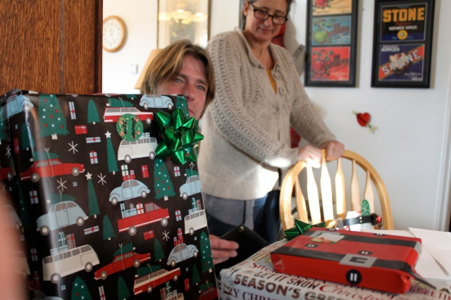 Greg and Sue behind presents