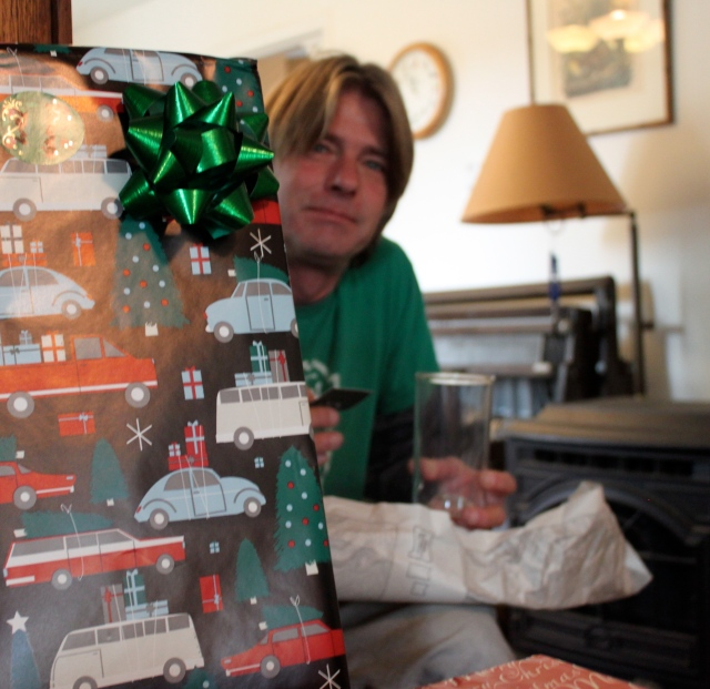 Greg with Mount Saint Helens pint glass behind presents