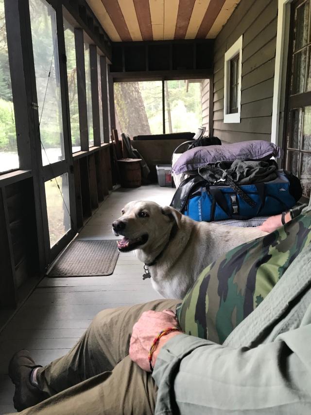 5 MAY Steve on front porch stone cabbin May 2019