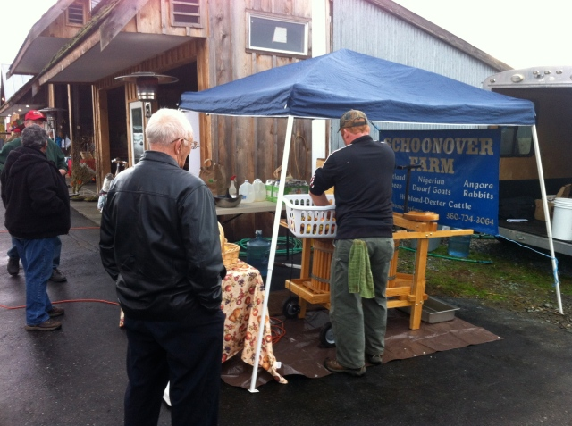 tom pressing cider at market 1012