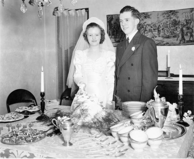 John and Ruth Stone wedding photo with china