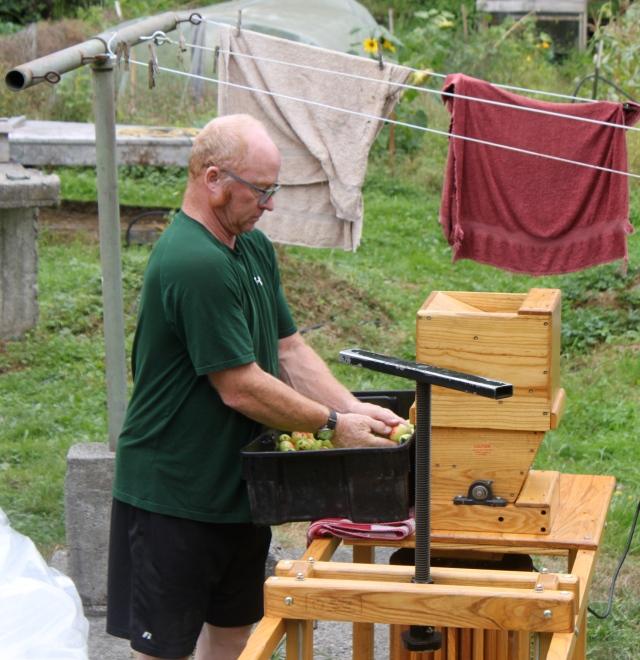 Tom grinding apples