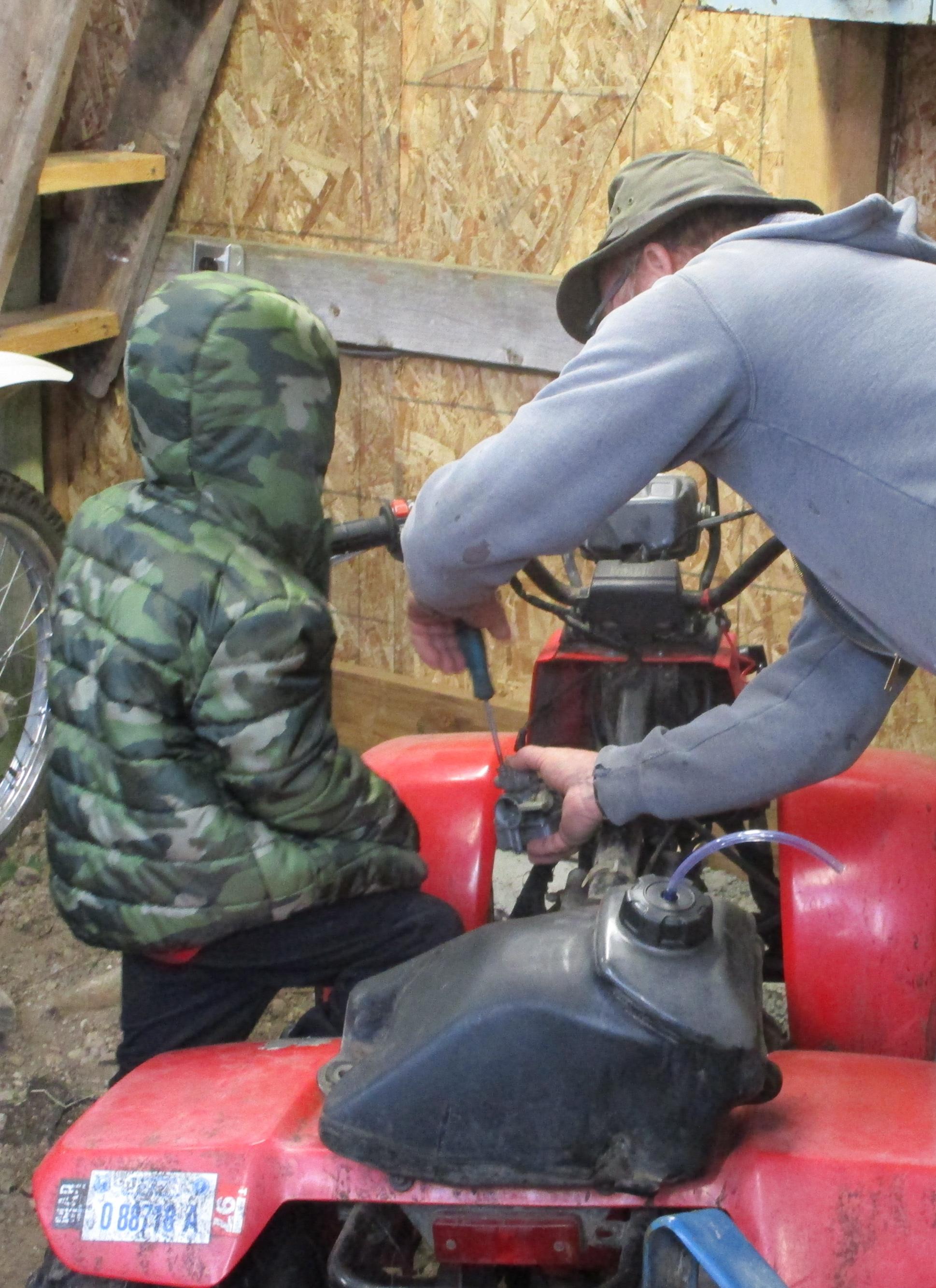 Tom showing William how to repalce quad carburator