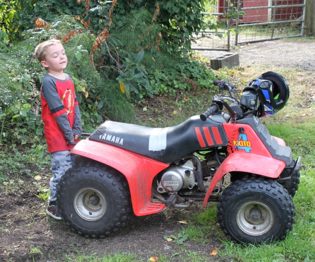 William showing how he can lift the back of the quad
