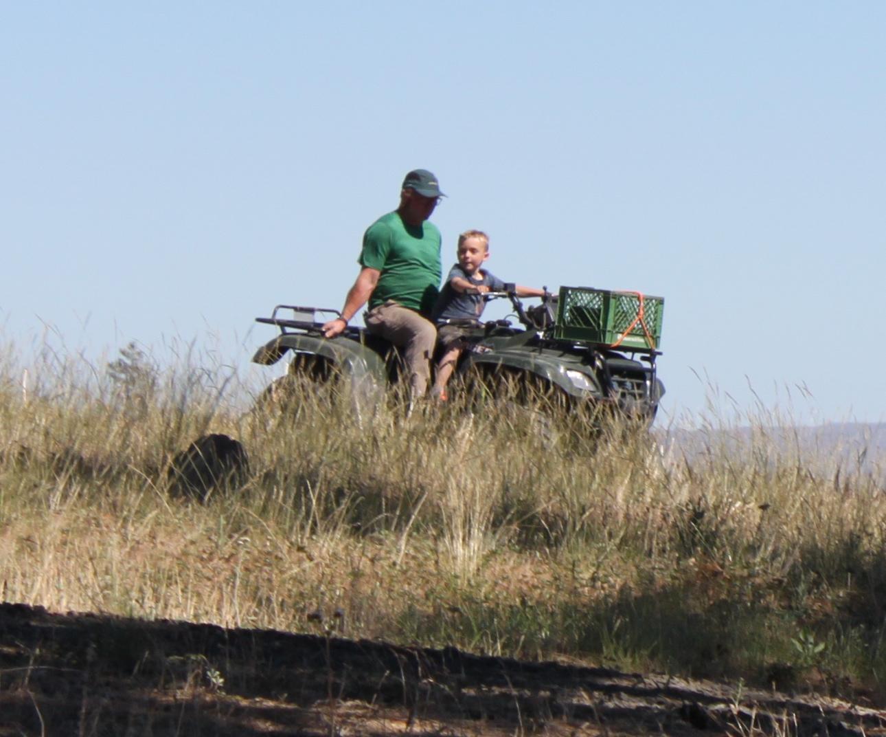 William driving Tom on quad